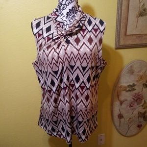 Burgundy tan brown shell top. Size Large